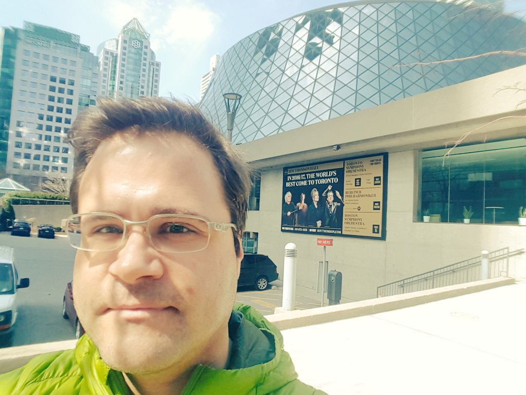 Here in front of Roy Thompson Hall, home of the Toronto Symphony. Good thing I am better at viola than taking selfies!